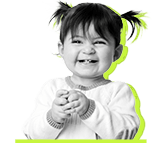 Smiling little girl with pig tails black and white