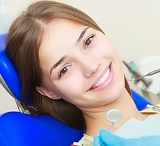 Young girl in dental chair smiling
