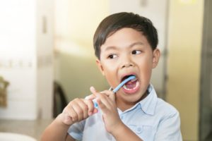 child brushing their teeth