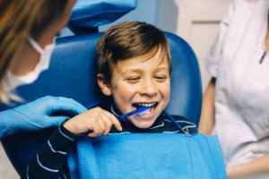 little boy seeing pediatric dentist