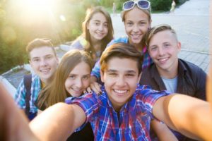Teens enjoying summer after visiting their Garland dentist