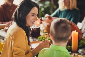 Mother eating with child using tips from children's dentist in Garland
