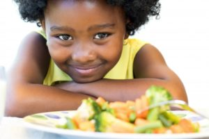 child eating healthy foods